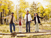 African family standing on fence — Stock Photo