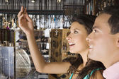 Hispanic couple looking at jewelry — Stock Photo