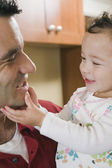 Mixed Race father smiling at baby — Stock Photo