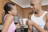 African couple drinking coffee — Stock Photo