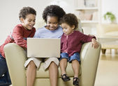 : African siblings looking at laptop — Stock Photo
