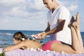 Hispanic woman receiving spa treatment — Stock Photo