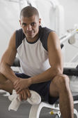 Hispanic man sitting in gym — Stock Photo
