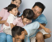 Asian family being silly — Stock Photo