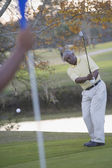African man playing golf — Stock Photo