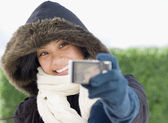 Pacific Islander woman taking own photograph — Stock Photo