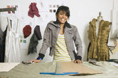 Indian female fashion designer in workshop — Stock Photo