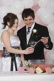 Hispanic man pouring punch for girlfriend at prom — Stock Photo