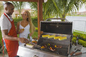 Multi-ethnic couple barbecuing — Stock Photo