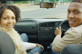 African couple driving in convertible car — Stock Photo