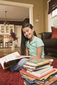 Pacific Islander girl reading library book — Stock Photo
