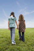 Multi-ethnic girls holding hands — Stock Photo