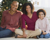 African family in front of Christmas tree — Stock Photo