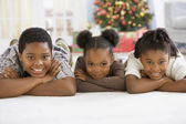 African siblings laying on floor — Stock Photo
