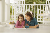 Hispanic mother and daughter coloring — Stock Photo