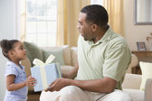 Mixed Race girl giving gift to father — Stock Photo