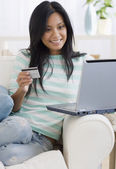 Pacific Islander woman shopping online — Stock Photo