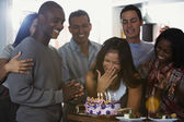 Asian woman celebrating birthday with multi-ethnic friends — Stock Photo