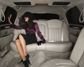 Middle Eastern woman sitting in limousine — Stock Photo