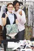 Multi-ethnic fashion designers giving thumbs up — Stock Photo