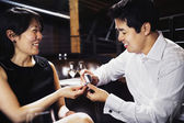 Asian man proposing to girlfriend — Stock Photo
