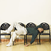 Mixed Race man laying in waiting area — Stock Photo