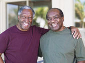 Senior African men hugging — Stock Photo