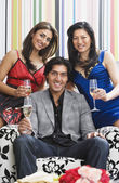 Multi-ethnic friends holding champagne — Stock Photo