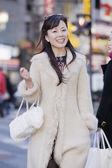 Asian woman in urban scene — Stock Photo