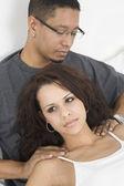 Hispanic man massaging wife's shoulders — Stock Photo