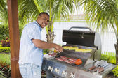 African man barbecuing — Stock Photo