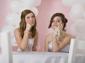 Bored multi-ethnic girls at prom — Stock Photo