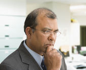 Indian businessman thinking — Stock Photo
