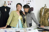 Multi-ethnic female fashion designers in workshop — Stock Photo