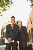 Asian businesspeople outdoors — Stock Photo