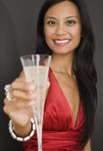 Pacific Islander woman holding champagne — Stock Photo