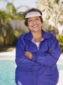 Senior Hispanic woman with arms crossed — Stock Photo