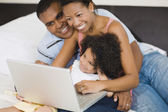 African family looking at laptop — Stock Photo