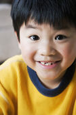 Close up of Asian boy smiling — Stock Photo