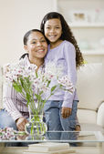Mixed Race mother and daughter hugging — Stock Photo