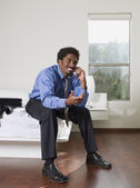 African businessman talking on cell phone — Stock Photo