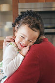 Mixed Race father and baby hugging — Stock Photo