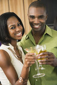African couple toasting with cocktails — Stock Photo