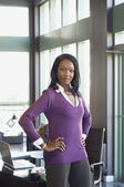 African businesswoman with hands on hips — Stock Photo
