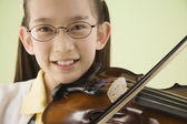 Asian girl playing violin — Stock Photo