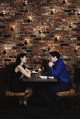 Asian couple eating at restaurant — Stock Photo