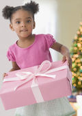 Mixed Race girl holding gift — Stock Photo