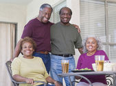 Senior African couples relaxing on patio — Stock Photo