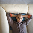 African American man laying on sofa — 图库照片