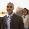 African American businesspeople in front of freighter — Stock Photo